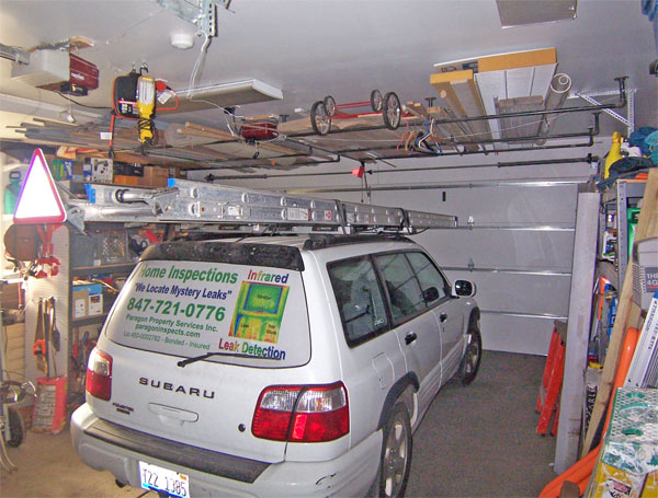 Dave is right about being careful not to overload the rack   I can get away  with that load because the garage ceiling is the underside of the floor of  my. Above garage door storage   DoItYourself com Community Forums